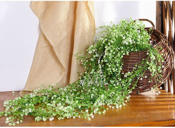 Kennedy blue budget-friendly wedding decorations greenery