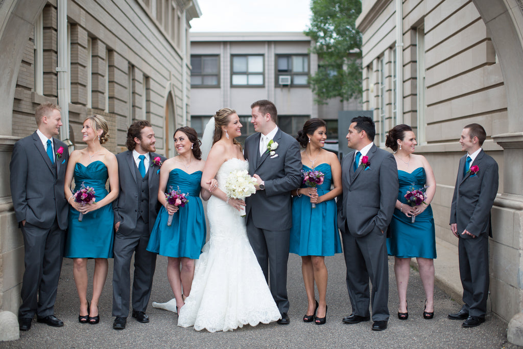 Taffeta bridesmaid dresses and gray men's suits. | A Romantic Jewel-Tone Wedding