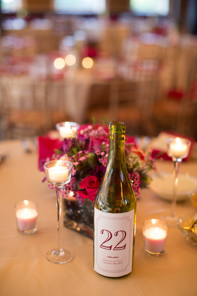DIY wine bottle table numbers. | A Romantic Jewel-Tone Wedding