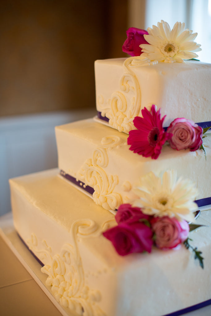 A gorgeous and classic tiered wedding cake. | A Romantic Jewel-Tone Wedding