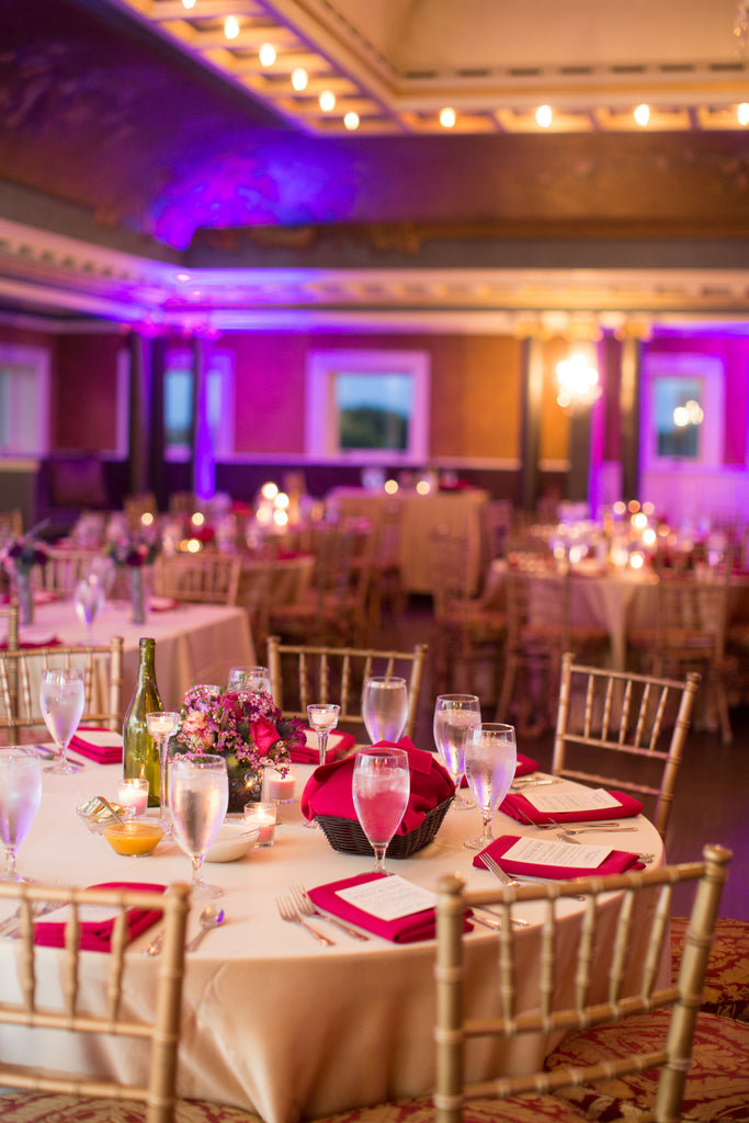 Elegant pink table settings in the Semple Mansion ballroom. | A Romantic Jewel-Tone Wedding