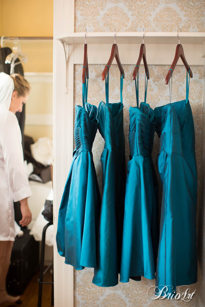 Teal blue, strapless taffeta bridesmaid dresses are perfect for any season.  | A Romantic Jewel-Tone Wedding