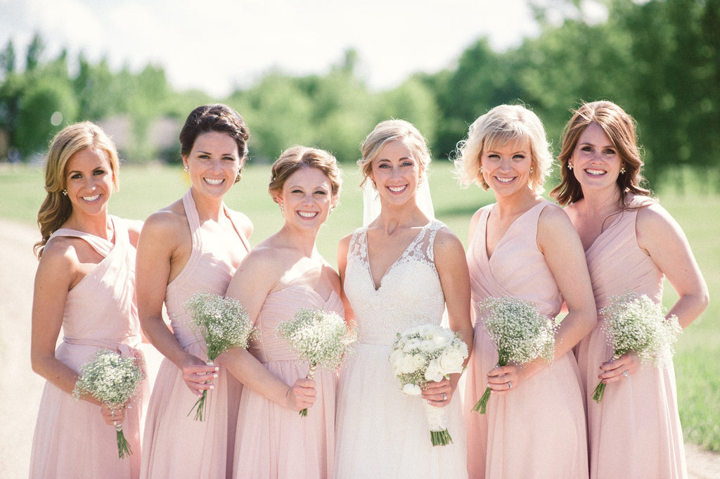 Mix and match blush pink bridesmaid dresses from Kennedy Blue!
