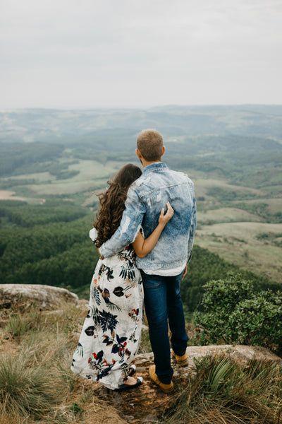 couple standing together in front of view | how to create a non-religious wedding script