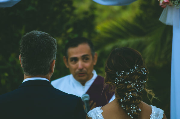 wedding officiant talking to couple | How to Find a Wedding Officiant