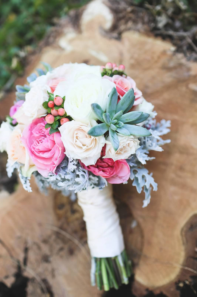 A gorgeous bridal bouquet with flowers and succulents. | A Whimsical Autumn Wedding | See the full gallery here!