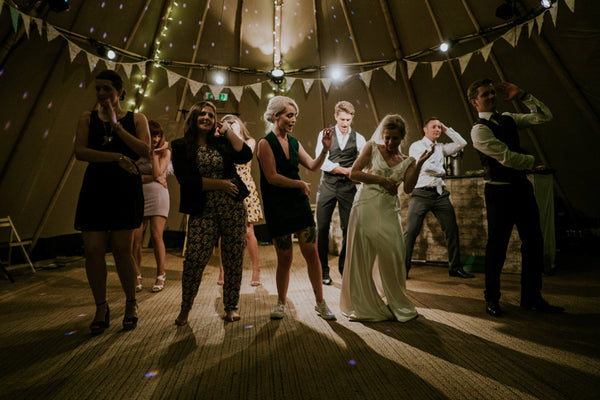 people dancing | How to Create a Wedding Playlist that Rocks