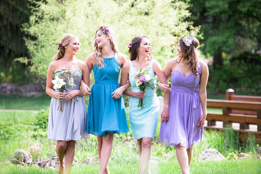 Style your bridesmaids in completely different dresses and colors for a fun mix and match look! | How to Nail the Mix and Match Trend
