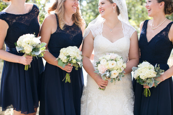 Chic lace-top bridesmaid dresses at a gorgeous outdoor wedding ceremony.