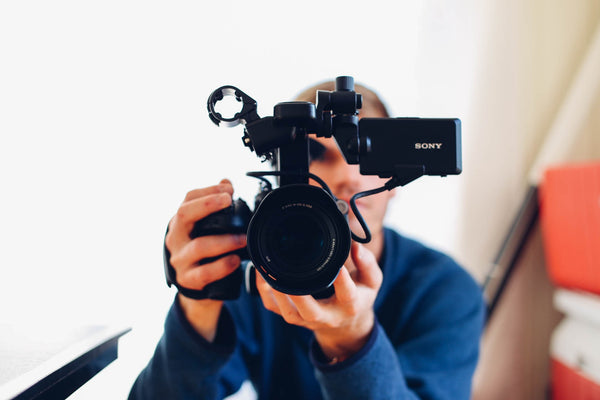 man taking video | Questions to Ask Your Wedding Videographer