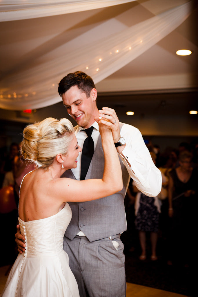 Kelly and Jake looked so happy sharing their first dance! | A Simple Wedding Dress for a Lakeside Ceremony