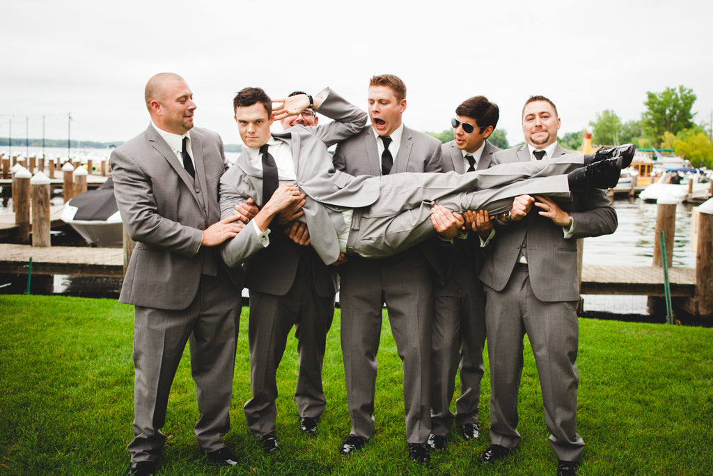 These groomsmen were handsome in their classic gray suits. | A Simple Wedding Dress for a Lakeside Ceremony