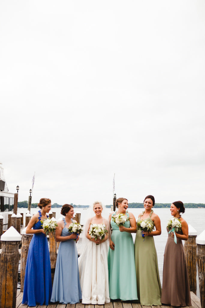 Gorgeous mismatched bridesmaid dresses in different colors. | A Simple Wedding Dress for a Lakeside Ceremony