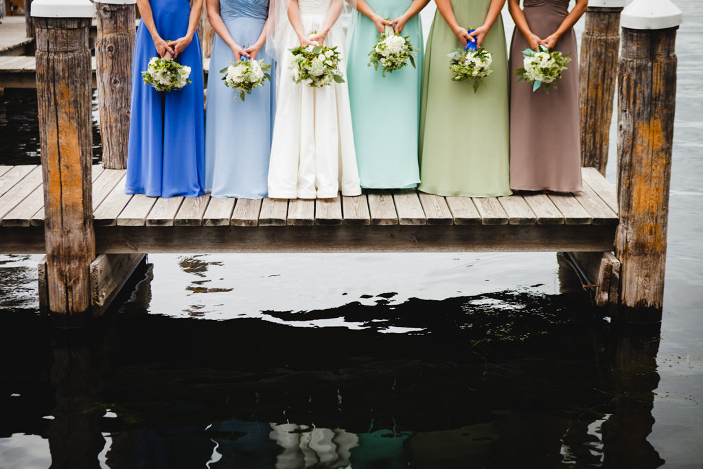 Mix and match bridesmaid dresses for a fun and unique look! | A Simple Wedding Dress for a Lakeside Ceremony