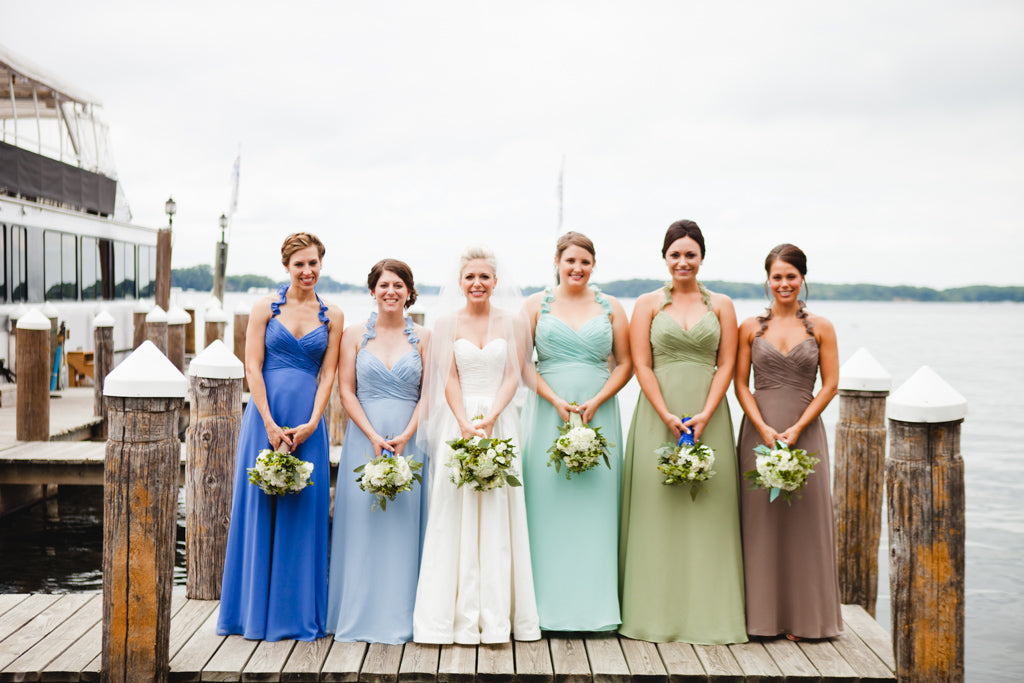 These ladies wore mix-and-match bridesmaid dresses - the same style in different colors. | A Simple Wedding Dress for a Lakeside Ceremony