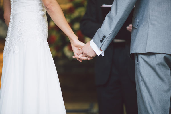 couple holding hand during wedding ceremony | How to Find a Wedding Officiant