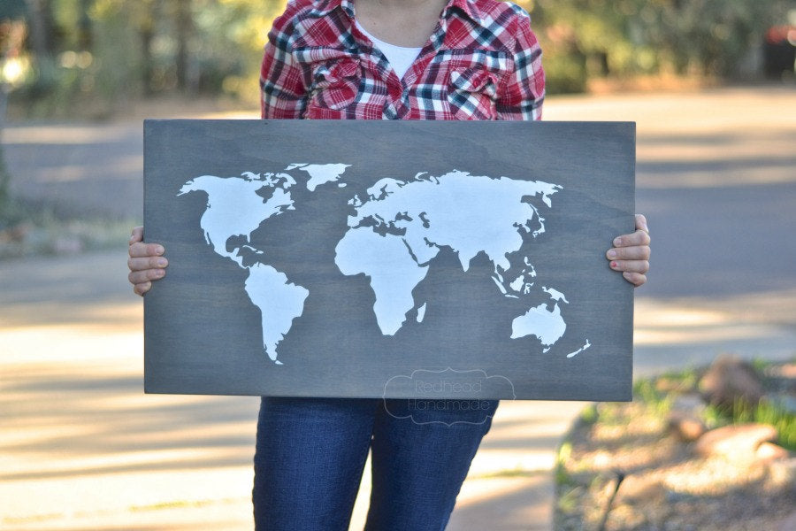 A large wooden world map for your wedding guestbook that you can later hang in your home! | Ways to Use Maps and Globes in Your Wedding Decor