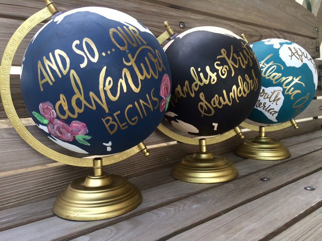 Personalizes globes for a wedding guestbook! | Ways to Use Maps and Globes in Your Wedding Decor