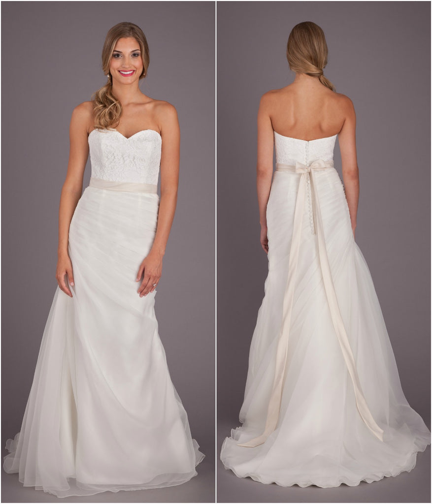 A unique bridal gown with a lace top and fitted, organza bottom. | Wedding Dresses Under $1000