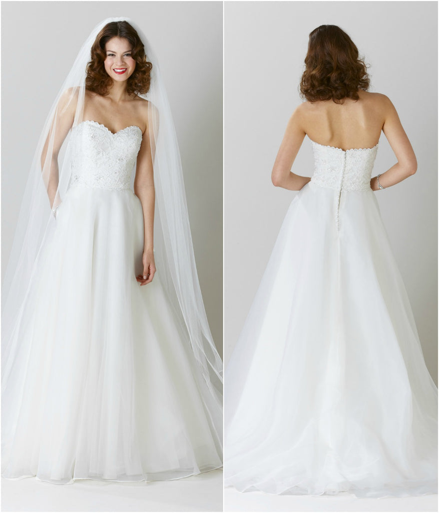 An affordable A-line bridal gown with a lace top and organza skirt. | Wedding Dresses Under $1000