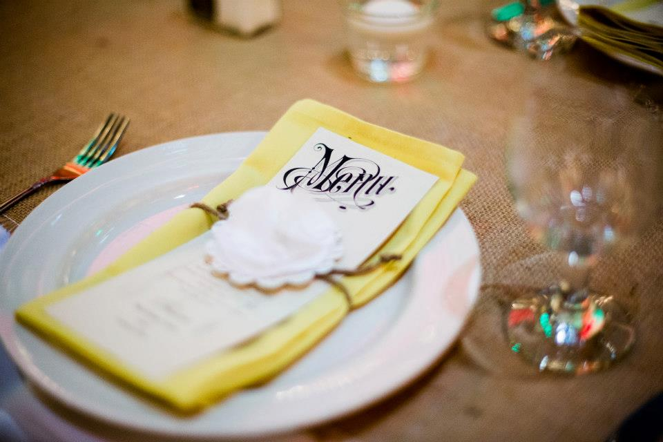 Fancy up the table linens by elegantly folding the napkins and adding a dinner menu.