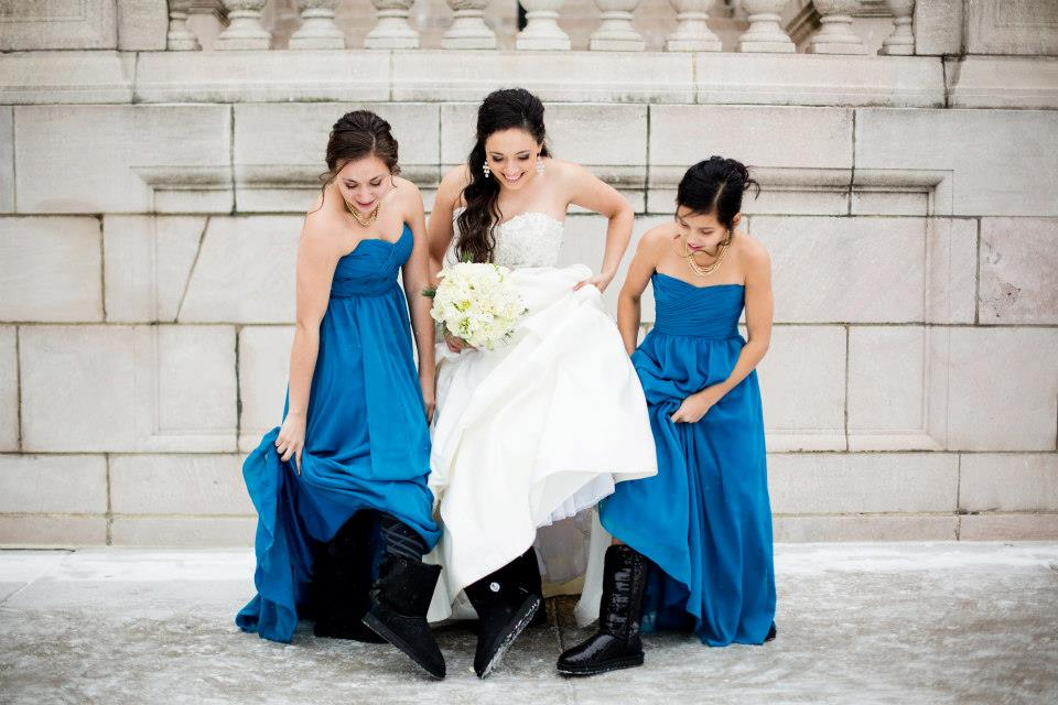 Wear leggings and boots underneath floor-length dresses to stay warm during a winter wedding! | Styling Winter Bridesmaid Dresses