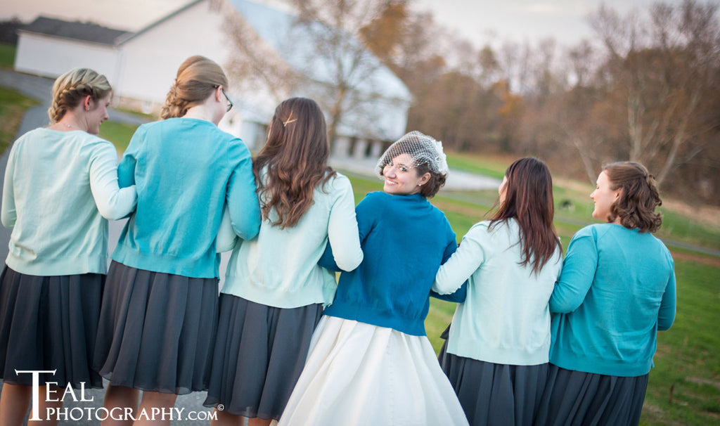 Cover up with a warm cardigan for your winter wedding! | Styling Winter Bridesmaid Dresses