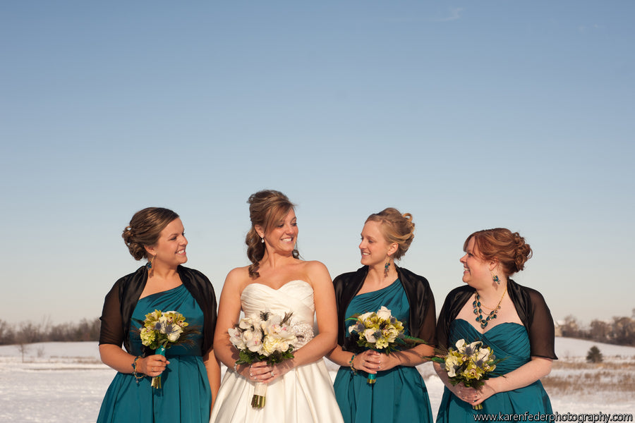 Shalls and cardigans are a cute and practical way to stay warm at a winter wedding. | Styling Winter Bridesmaid Dresses