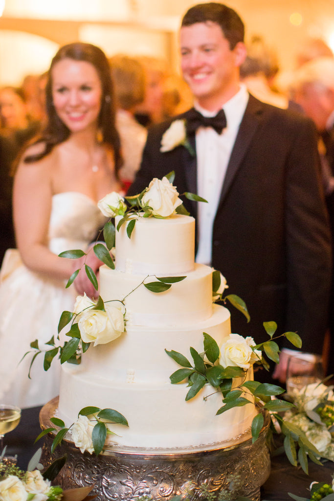 A white, winter wedding cake. | A Romantic Winter-Themed Wedding