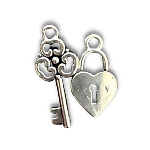 silver lock and key charms go on the magnetic couple bracelets - OurCoordinates
