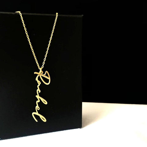 gold vertical name necklace on black stand - OurCoordinates