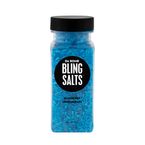 Small, clear plastic jar filled with blue bath salt that smells like blueberry lemongrass. Contains a fun surprise inside.
