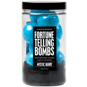 Fortune Telling Bombs Jar with blue mini bath bombs and a black loofah, scented as mystic berry.