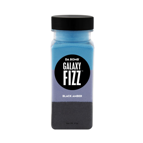 Small, clear plastic jar containing color block blue, purple and black bath fizz that smells like black amber. Jar contains a fun surprise.