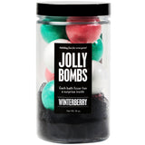 Jolly Bombs with holiday colored mini bath bombs scented as winterberry. Includes a black luffa.
