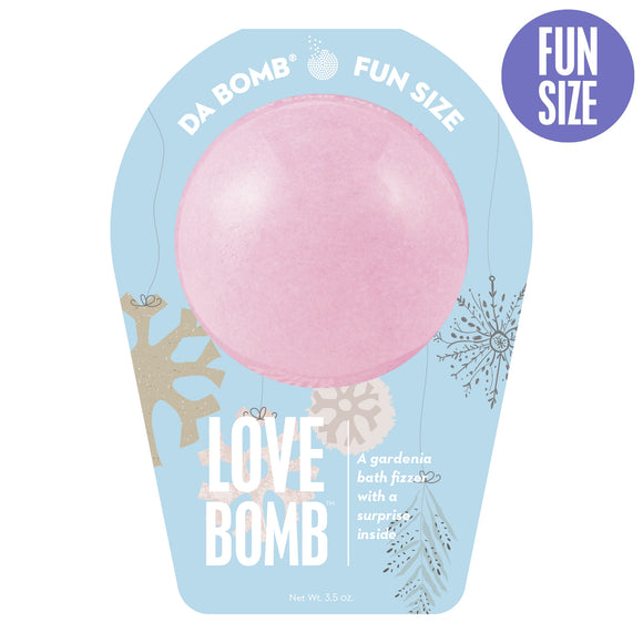 Pink gardenia bath bomb in blue seasonal packaging.