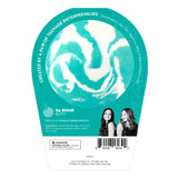 Back of the Ariel bath bomb in packaging. Bath bomb is white with teal swirl on the back.