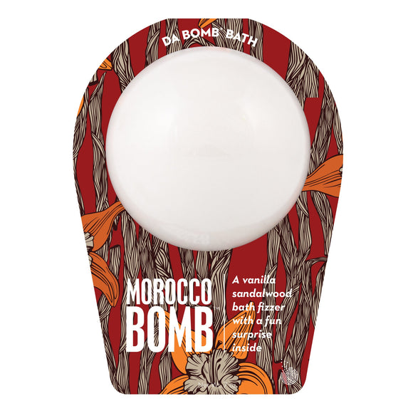 White morocco Bomb with a surprise inside, scented as vanilla sandalwood in travel themed packaging.