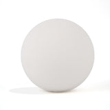 White round bath bomb out of packaging on white background.