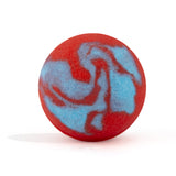 Red and blue swirl round bath bomb out of packaging on white background.