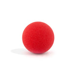 Red round bath bomb out of packaging on white background.