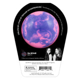 Back of fairy bath bomb in packaging. Bath bomb is purple and pink swirl on the back.