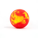 Red and yellow round bath bomb out of packaging on white background.