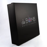 Black gift box with the Da Bomb logo on the front.