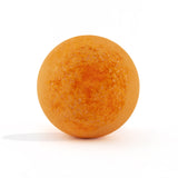 Unpackaged orange bath bomb with suagr topping, scneted as tangerine, on a white background.