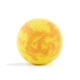 Orange and yellow swirl Beach Bomb with a surprise inside, scented as island mango without packaging.