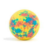 Yellow with red and blue splotches bath bomb, with a surprise inside, scented as passion fruit on white background without packaing.