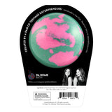 Back of the Mermaid bath bomb in black packaging. Bath bomb is teal and pink swirl on the back.