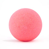 Neon pink bath bomb without packaging on white background and scented as pink grapefruit.