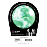 Back of the Mystery bath bomb in black packaging. Bath bomb is green with white swirl on the back.